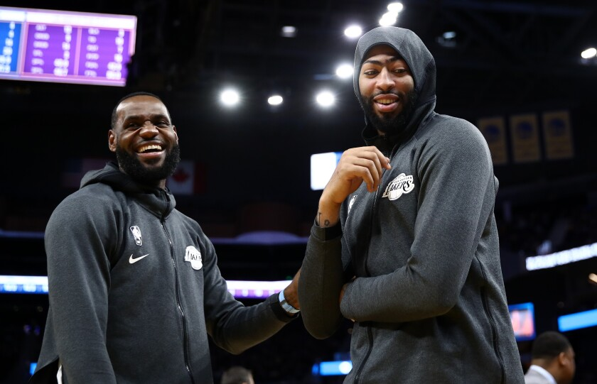 Lakers stars LeBron James, left, and Anthony Davis share a laugh.