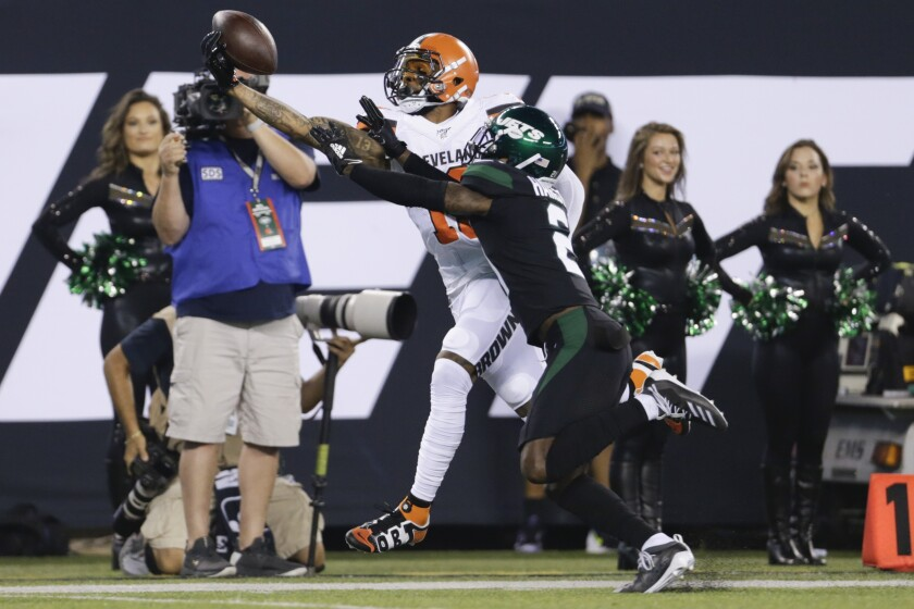 Cleveland Browns wide receiver Odell Beckham makes a one-handed catch in front of New York Jets cornerback Nate Hairston.