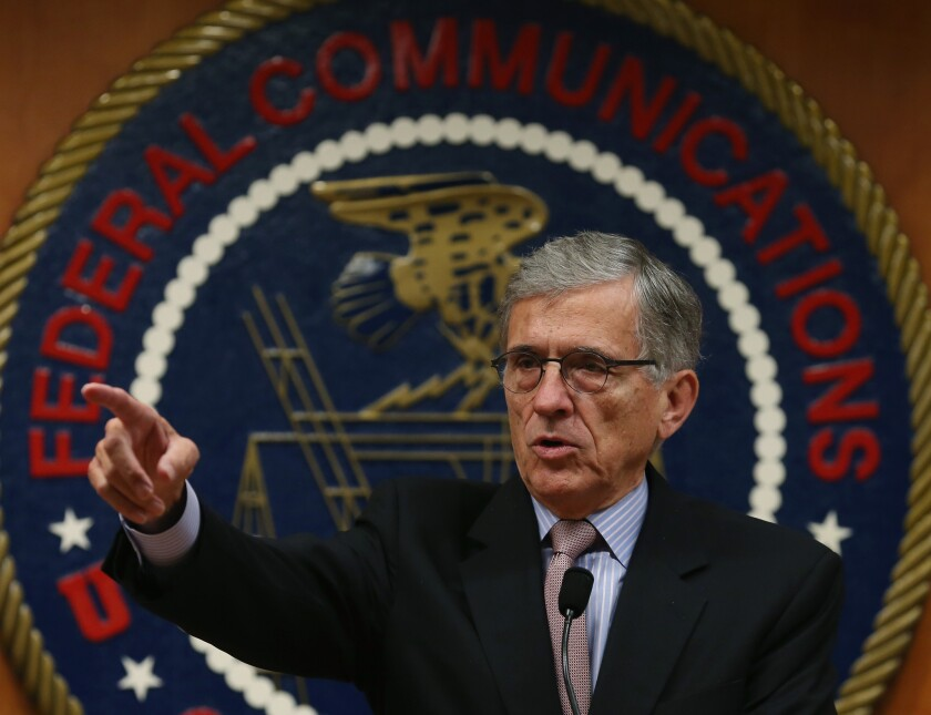 FCC Chairman Tom Wheeler, shown at a roundtable discussion in Washington, D.C., in September, addressed net neutrality rules, spectrum auctions and other contentious issues during a question-and-answer session at the Consumer Electronics Show in Las Vegas on Wednesday.