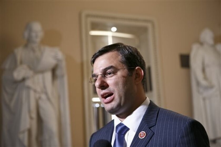 Rep. Justin Amash, R-Mich., comments about the vote on the defense spending bill and his failed amendment that would have cut funding to the National Security Agency's program that collects the phone records of U.S. citizens and residents, at the Capitol, Wednesday, July 24, 2013. The Amash Amendme