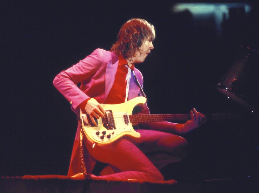 Chris Squire performs with Yes at a concert in Champaign, Ill., in 1979. Squire was the only member of the band to play on every one of its albums.