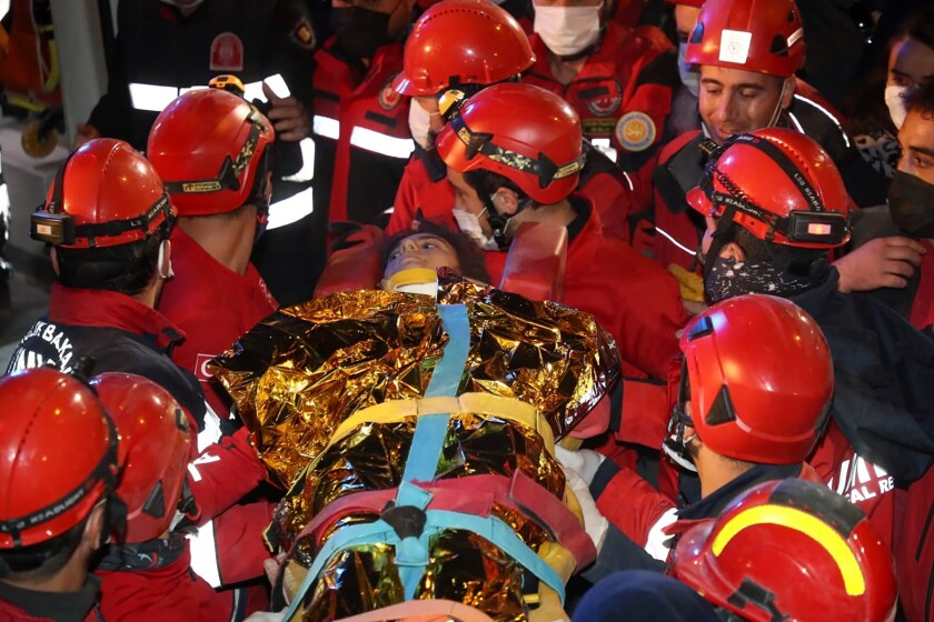 Rescue workers carry 14-year-old Idil Sirin out from the rubble of a collapsed building early Monday.