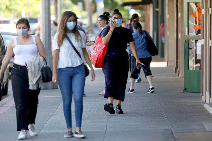 Shoppers wearing masks at the Orange Circle in Orange on Thursday.