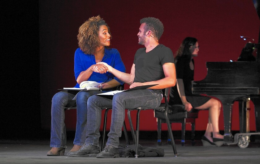 """Cooper Howell and Tiana Okoye act in """"Blind Fight"""" by Ehtan Carlson and Saidu Sinlah during a musical-writing competition called Showsearch at UCI's Claire Trevor Theatre on Saturday."""