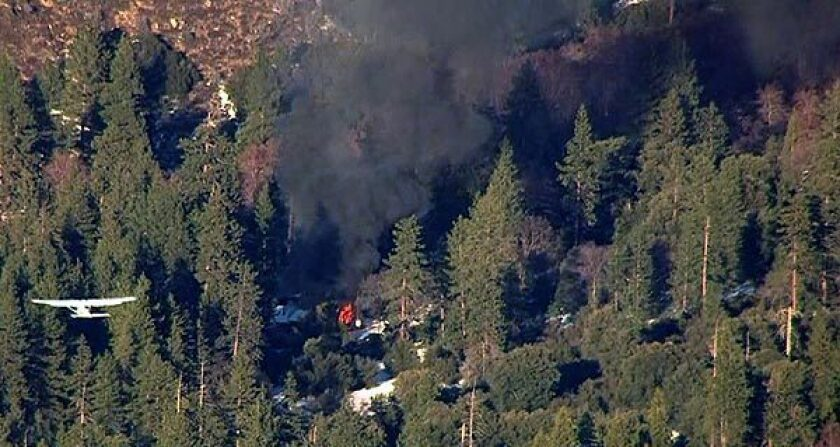 Fire engulfs a home in the Big Bear area where fugitive murder suspect Christopher Dorner was believed to be holed up after a shootout with sheriff's deputies.
