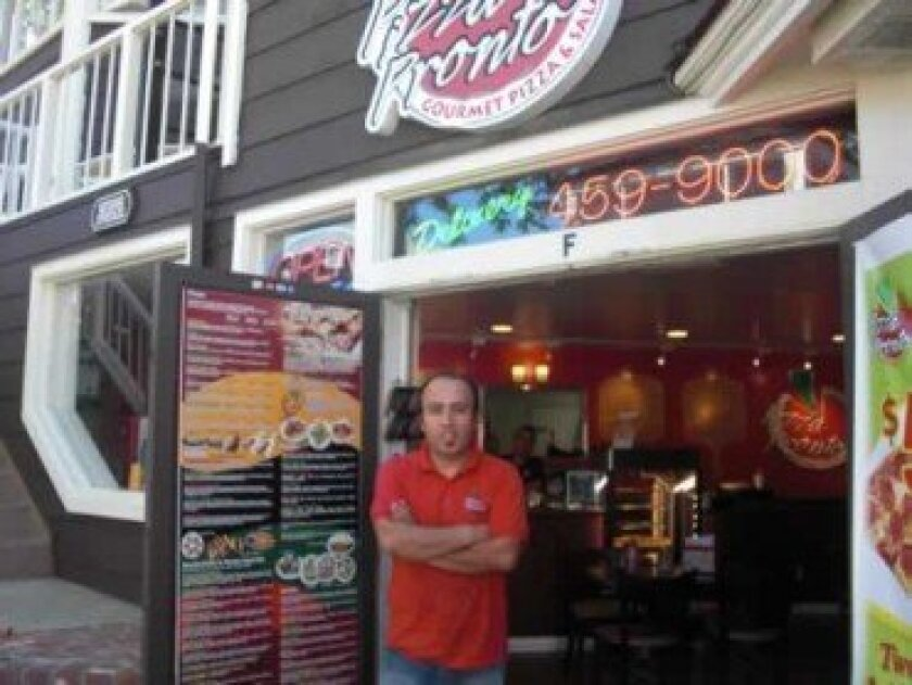 Sam Qadiri, owner of Pizza Pronto on Fay Avenue   -Photo by Linda Hutchison