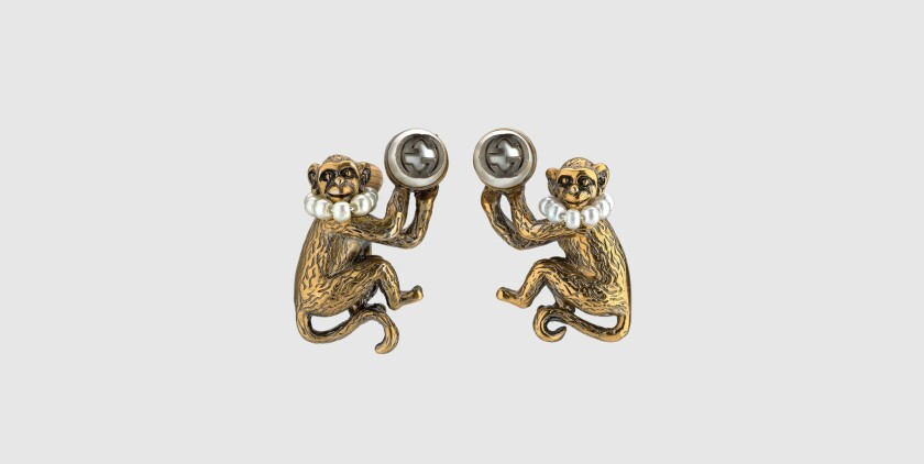 Gucci golden metal monkey earrings