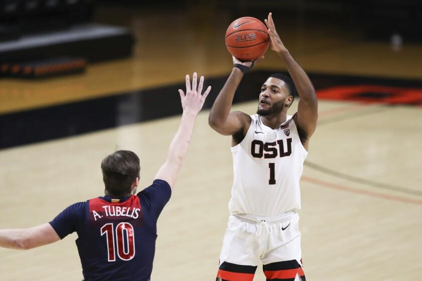 Oregon State's Maurice Calloo (1) shoots over Arizona's Azuolas Tubelis (10) during the first half of an NCAA college basketball game in Corvallis, Ore., Thursday, Jan. 14, 2021. (AP Photo/Amanda Loman)