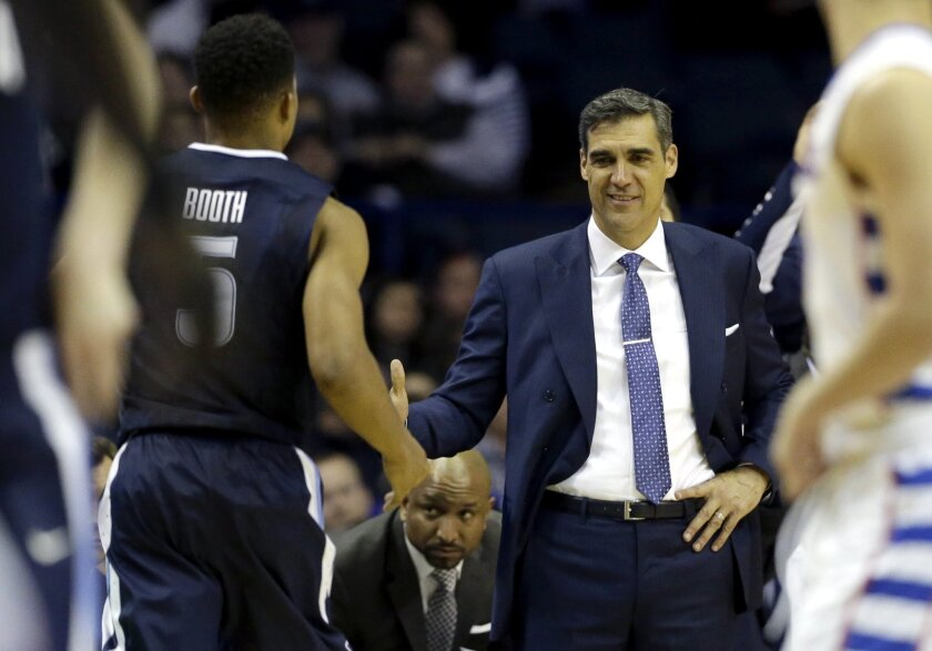 Villanova head coach Jay Wright, right, celebrates with guard Phil Booth during the second half of an NCAA college basketball game against DePaul  Tuesday, Feb. 9, 2016, in Rosemont, Ill. Villanova won 86-59. (AP Photo/Nam Y. Huh)