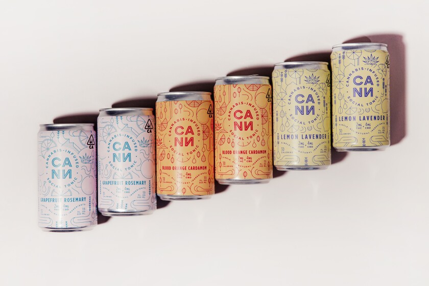 Six cans of THC-infused beverages arranged on a diagonal.