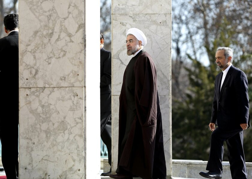 Iran's President Hassan Rouhani arrives to Saadabad palace for a meeting with Afghan President Hamid Karzai in Tehran, Iran, Sunday, Dec. 8, 2013. Karzai arrived in Tehran for a one-day visit on Sunday to discuss regional and international issues with Iranian officials. (AP Photo/Ebrahim Noroozi)