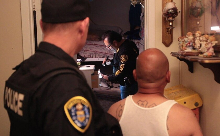 Parole officers do a compliance check on a sex offender in his home in National City on Halloween night in 2013