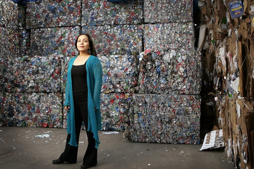 Seema Sueko (shown at Miramar Recycling Center) and her theater company Mo'olelo Performing Arts Company have been at the forefront of developing strategies to reduce waste and other environmental impacts from the construction and disposal of used theater scenery.