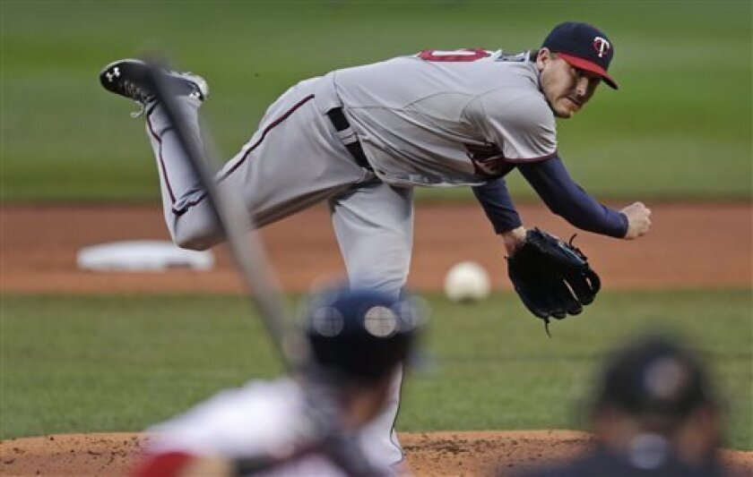 Minnesota Twins starting pitcher Kevin Correia delivers during the first inning of a baseball game against the Boston Red Sox at Fenway Park in Boston, Thursday, May 9, 2013. (AP Photo/Charles Krupa)