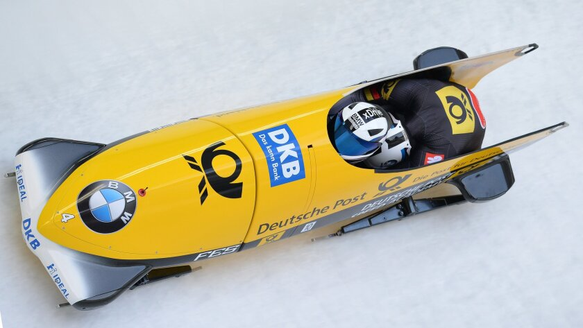 Francesco Friedrich and Thorsten Margis of Germany speed down the track  during their third run of the two-man bob race at the Bob World Championships  in Igls, near Innsbruck, Austria, on Sunday, Feb. 14, 2016. (AP Photo/Kerstin Joensson)