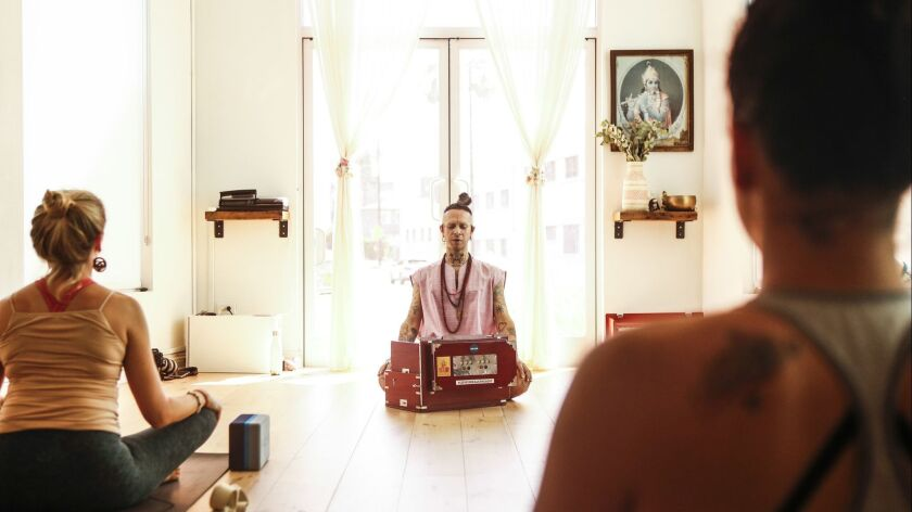LOS ANGELES, CA -- SATURDAY, AUGUST 31, 2018-- While students are lying in savasana, Puja plays the