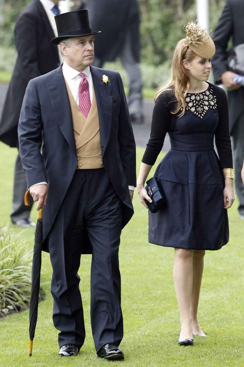 Britain's Prince Andrew, Duke of York, and his daughter Princess Beatrice arrive for the Ladies' Day of Royal Ascot in England. Ascot is well known for its strict dress code of hats.