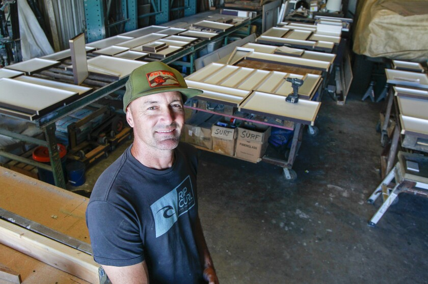 Jack Cooper, owner of Jax Design Shop, at his Carlsbad shop. In the background are shapes for concrete tiles, all of which, will be used in a bathroom remodel in northern California.