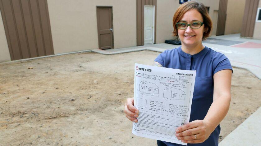 Orange County-based Women's Transitional Living Center CEO Gigi Tsontos shows the plans for a 12-foo