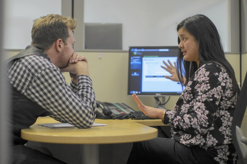 Client Paul Chirico of L.A. works with H&R Block tax preparer Erika Arbulante to see how the Affordable Care Act will affect his taxes. Many Americans miscalculated their income last year, affecting their subsidy levels.