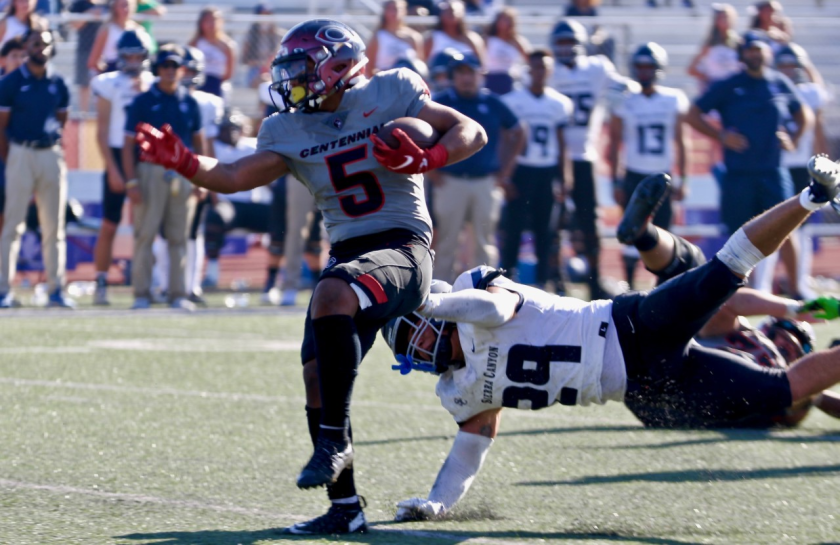 Centennial tailback Jayson Cortes sheds a tackle by Sierra Canyon linebacker Angelo Pulido in the first half.