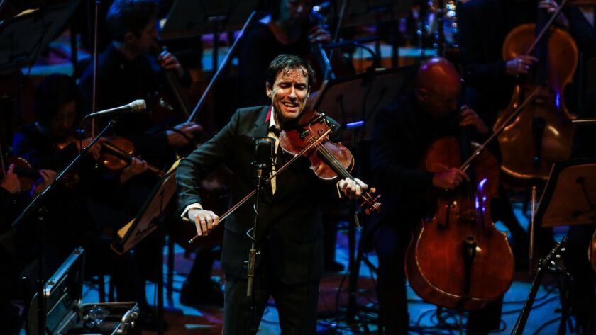 """Andrew Bird performs his """"Time Is a Crooked Bow"""" with Gustavo Dudamel and the Los Angeles Philharmonic at Walt Disney Concert Hall as part of the orchestra's L.A. Fest."""