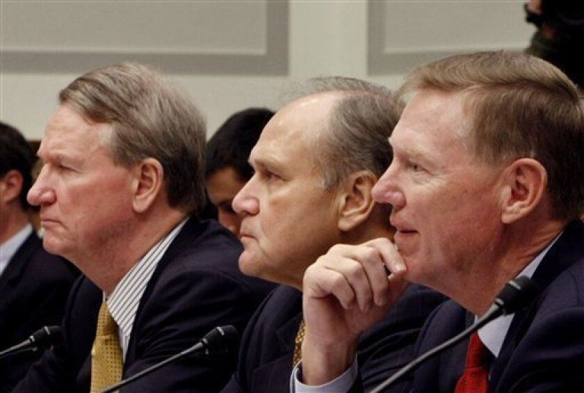 In this Nov. 19, 2008 file photo, auto industry executives, from left, General Motors Chief Executive Officer Richard Wagoner; Chrysler Chief Executive Officer Robert Nardelli; and Ford Chief Executive Officer Alan Mulally, testify on Capitol Hill in Washington before a House Financial Services Committee hearing on the automotive industry bailout. Detroit's automakers, making a second bid for $25 billion in funding, are presenting Congress with plans Tuesday, Dec. 2 to restructure their ailing companies and provide assurances that the funding will help them survive and thrive. (AP Photo/Gerald Herbert, file)