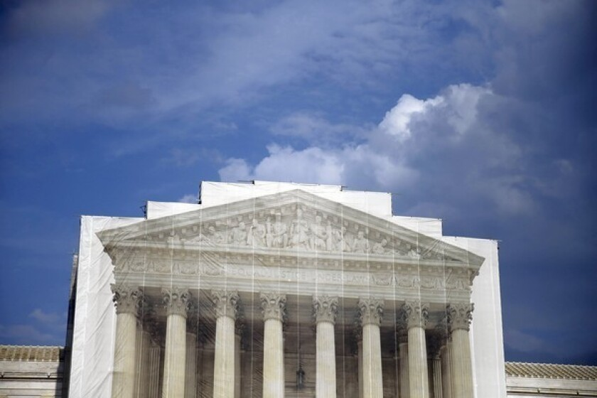 The U.S. Supreme Court, shown under scaffolding in August, is continuing operations despite the federal government shutdown.
