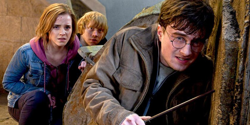 "Hermione Graner (Emma Watson), Ron Weasley (Rupert Grint) and Harry Potter (Daniel Radcliffe) battle their way through ""Harry Potter and the Deathly Hallows - Part 2."""