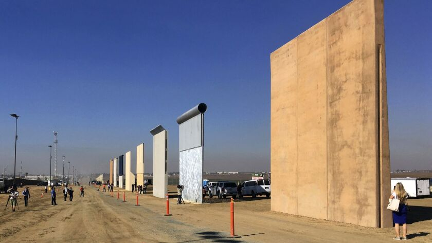 FILE - This Oct. 26, 2017 file photo shows prototypes of border walls in San Diego. A federal appeal