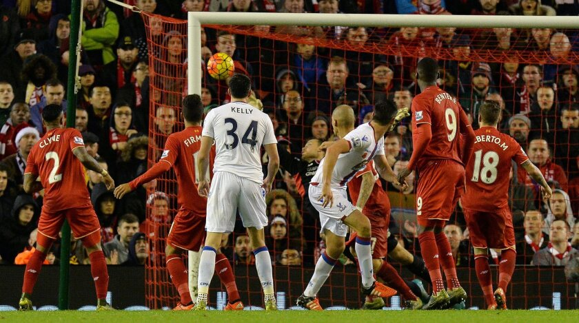 Crystal Palace's Scott Dann, third right, scores his team's second goal against Liverpool during the English Premier League soccer match at Anfield, Liverpool, England, Sunday Nov. 8, 2015. (Martin Rickett/PA via AP) UNITED KINGDOM OUT