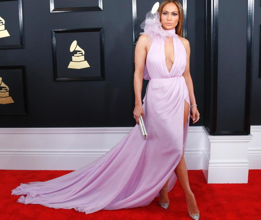 Jennifer Lopez goes for a pretty-in-pink look during the arrivals at the 59th Annual Grammy Awards.
