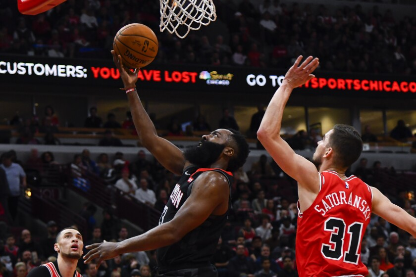 Houston Rockets guard James Harden, left, drives to the basket against Chicago Bulls guard Tomas Satoransky (31) during the first half of an NBA basketball game Saturday, Nov. 9, 2019, in Chicago. (AP Photo/Matt Marton)