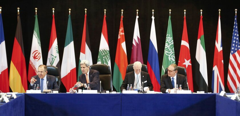 Russian Foreign Minister Sergey Lavrov , left, and U.S. Secretary of State, John Kerry , second left,  attend the International Syria Support Group (ISSG) meeting in Munich, Germany,Thursday Feb. 11, 2016, together with members of the Syrian opposition and other officials.  (Michael Dalder/Pool Pho