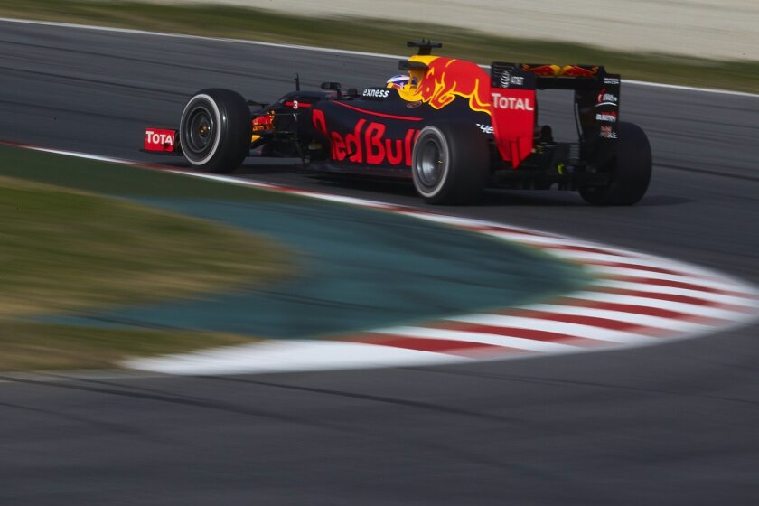 Daniel Ricciardo of Australia takes a curve in the new Red Bull F1 car during a testing session at the the Catalunya racetrack in Montmelo, outside Barcelona, Spain, Monday, Feb. 22, 2016. (AP Photo/Siu Wu)