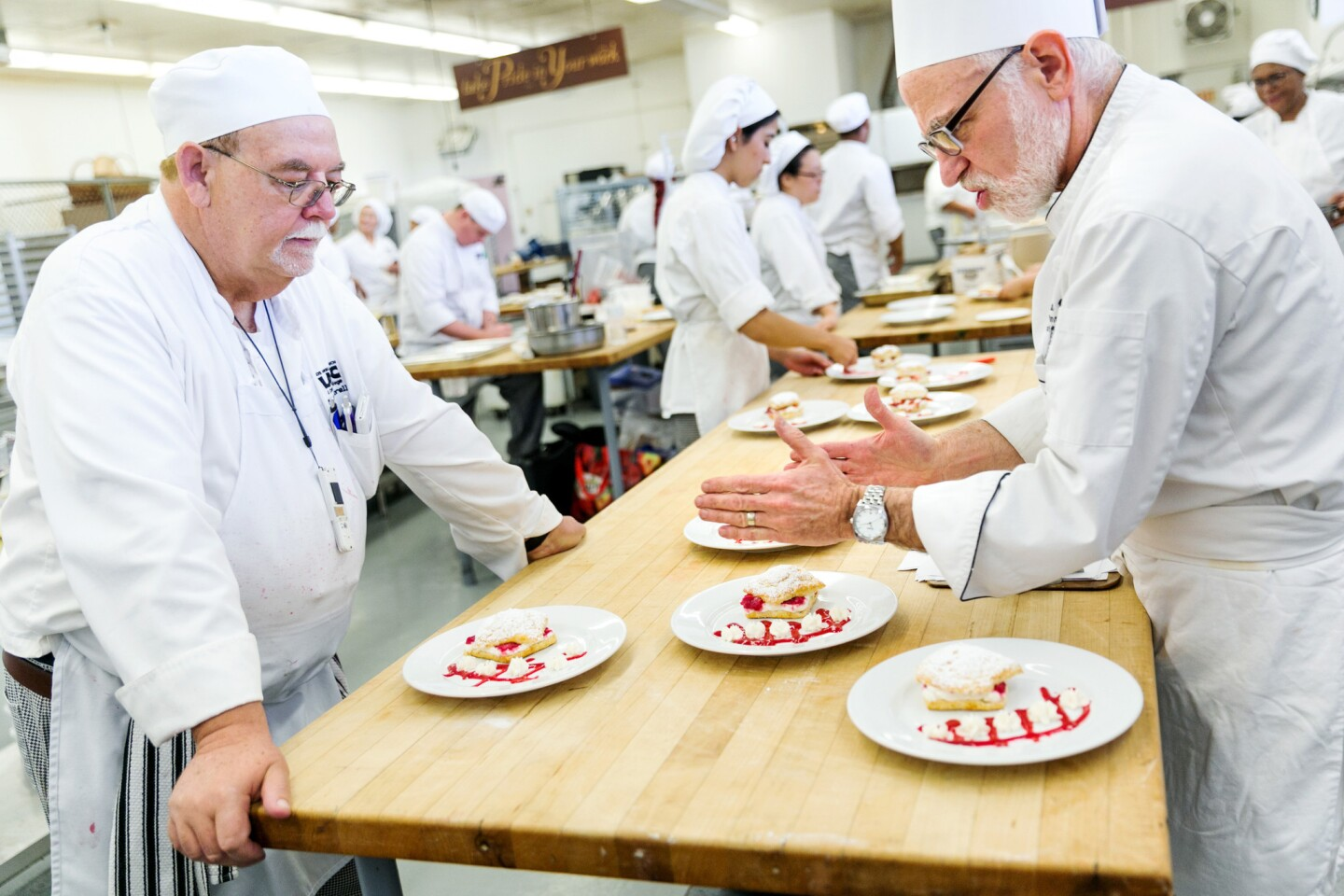 Melvin Norell, left, gets feedback from instructor Robert Wemischner in culinary class at Los Angeles Trade Tech.