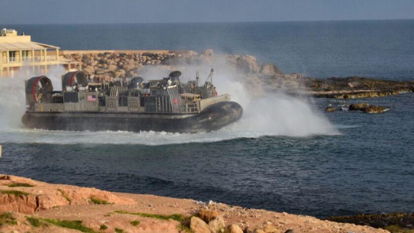 A U.S. amphibious hovercraft departs with evacuees from Janzur, west of Tripoli, Libya, Sunday, Apri