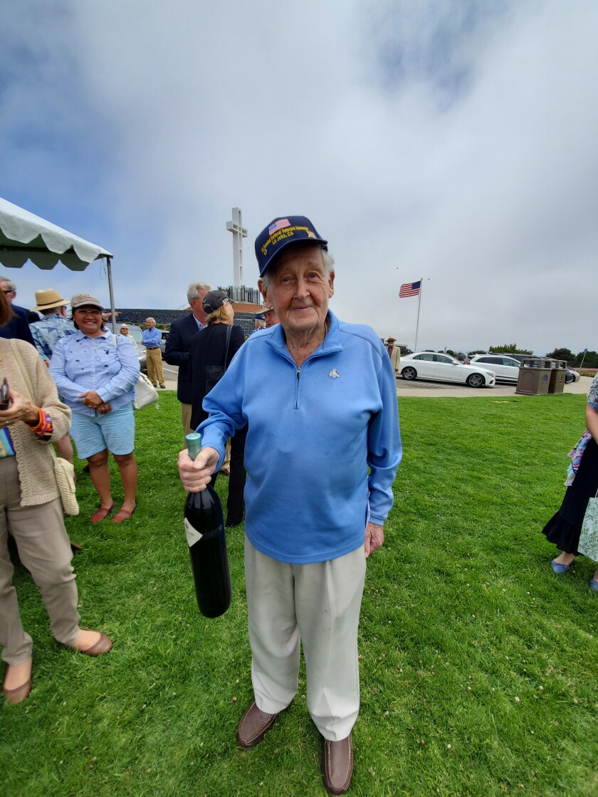 Max Gurney holds a gift bottle of wine at a celebration of his 100th birthday on June 30 atop Mount Soledad.