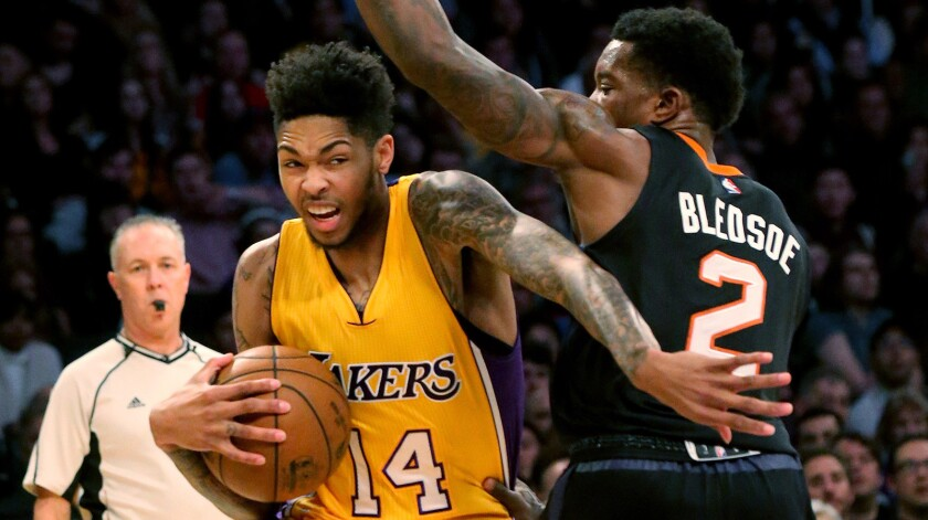 Lakers rookie Brandon Ingram drives to the basket against Suns guard Eric Bledsoe during a game at Staples Center on Dec. 9.