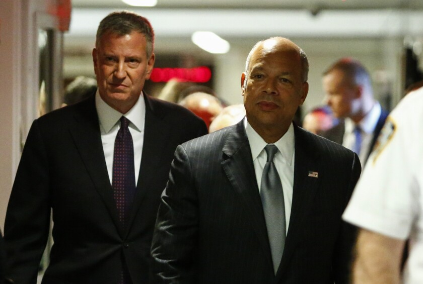 Mayor Bill de Blasio and Secretary of Homeland Security Jeh Johnson before a press conference on the recent police shootings across the country at One Police Plaza on July 8, 2016 in New York City.