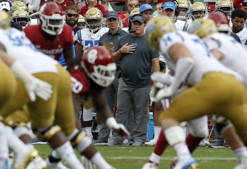 Coach Chip Kelly looks over a UCLA offensive line that continues to struggle.