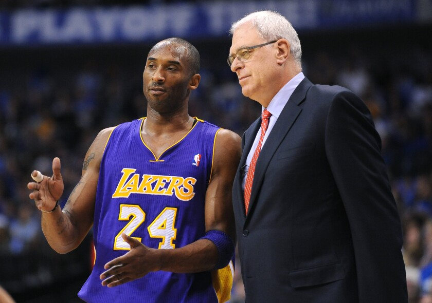 Lakers star Kobe Bryant speaks with coach Phil Jackson during Game 4 of the 2011 Western Conference semifinals.