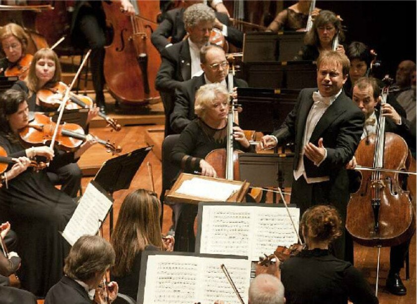 Conductor Ludovic Morlot with members of the Seattle Symphony.