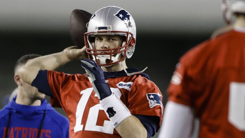 New England Patriots quarterback Tom Brady throws a pass during NFL football practice, Friday, Feb.