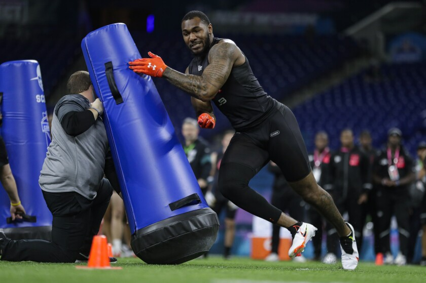 Alabama linebacker Terrell Lewis runs a drill at the NFL football scouting combine.