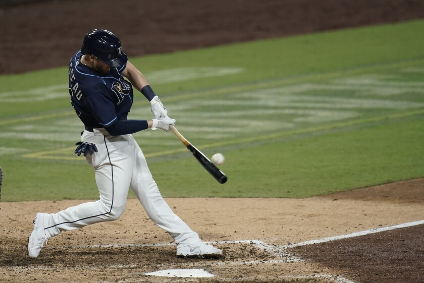 The Rays' Mike Brosseau hits a go-ahead homer during the eighth inning in Game 5 of the ALDS on Oct. 9, 2020.