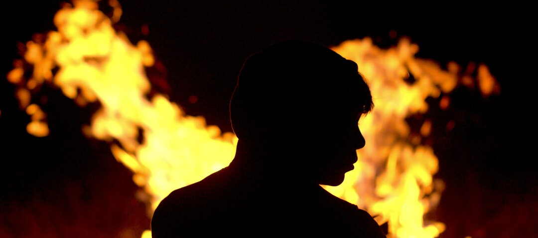"""Juan Jesús Varela is silhouetted by flames in a scene from """"Identifying Features."""""""