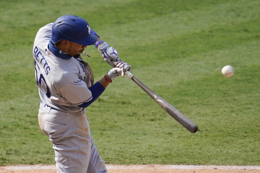 Dodgers right fielder Mookie Betts hits during an 8-3 win over the Angels.