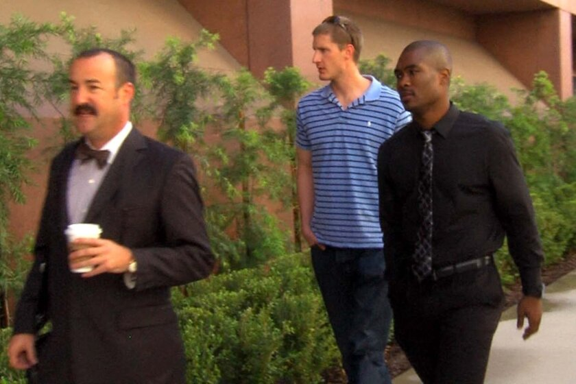 Former USD basketball player Brandon Johnson, right, walks into federal court in San Diego, where he was sentenced to prison in game fixing case.