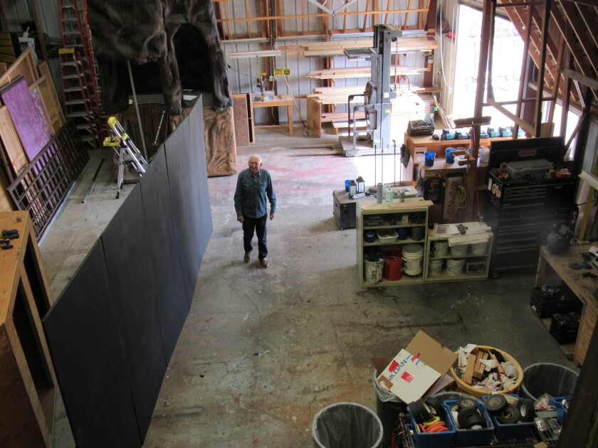 Bob Kuhne, the retired teacher who started it all for Peter Pan Junior Theater back in 1970, walks among set props, stage scenery, wardrobe items and more at the theater group's storage site near La Mesa Arts Academy.